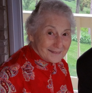 A picture of an elderly lady dressed in red.